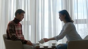 Family couple leisure communication drinking tea. Family couple leisure. communication. relaxing time. man and woman drinking tea at home stock footage
