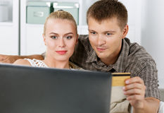 Family couple making shopping over internet Stock Photo