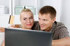 Family couple making shopping over internet Royalty Free Stock Image
