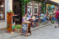 Family and a couple relax at a terrace on the Kraemerbruecke, Erfurt Royalty Free Stock Photo