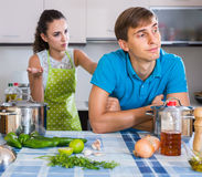 Family couple with serious faces quarrelling in kitchen Royalty Free Stock Photo