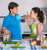 Family couple with serious faces quarrelling in kitchen Stock Photo