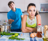 Family couple with serious faces quarrelling in kitchen Royalty Free Stock Photos