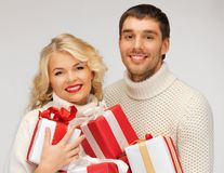 Family couple in a sweaters with gift boxes Stock Photos
