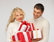 Family couple in a sweaters with gift boxes Royalty Free Stock Images