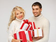 Family couple in a sweaters with gift boxes Royalty Free Stock Image