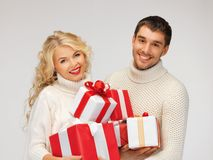 Family couple in a sweaters with gift boxes Royalty Free Stock Photography