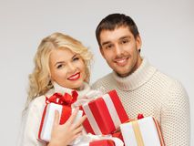 Family couple in a sweaters with gift boxes Royalty Free Stock Photos