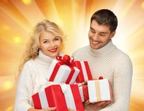Family couple in a sweaters with gift boxes Royalty Free Stock Photo