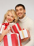 Family couple in a sweaters with gift boxes Stock Images