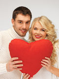 Family couple in a sweaters with heart Stock Photo