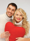 Family couple in a sweaters with heart Royalty Free Stock Photo