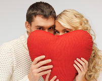 Family couple in a sweaters with heart Stock Image