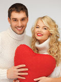 Family couple in a sweaters with heart Royalty Free Stock Photos