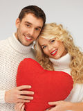 Family couple in a sweaters with heart stock images