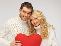 Family couple in a sweaters with heart Royalty Free Stock Images