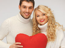 Family couple in a sweaters with heart Royalty Free Stock Image