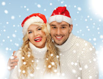 Family couple in sweaters and santa's hats Stock Photography