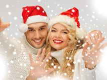 Family couple in sweaters and santa's hats Royalty Free Stock Photo