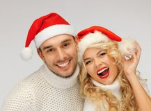 family couple in sweaters and santa's hats Stock Image