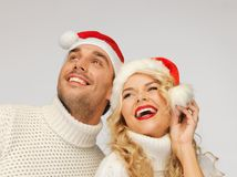 Family couple in sweaters and santa's hats Stock Photo
