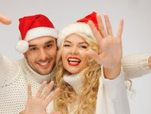 family couple in sweaters and santa's hats Stock Images