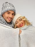 Family couple under warm blanket Stock Image