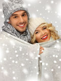 Family couple under warm blanket Royalty Free Stock Image