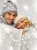 Family couple under warm blanket Stock Images