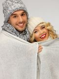 Family couple under warm blanket Royalty Free Stock Photo