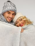 Family couple under warm blanket Royalty Free Stock Images