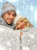 Family couple under warm blanket Stock Photo