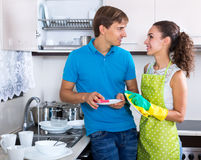 Family couple washing dishes royalty free stock photography