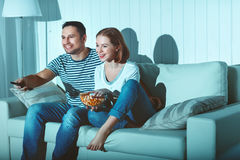 Family couple watching television at home on sofa. Family couple watching television at home on the sofa Royalty Free Stock Image