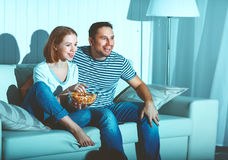 Family couple watching television at home on sofa. Family couple watching television at home on the sofa Stock Photo