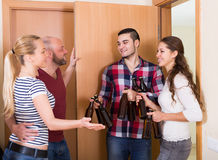 Family couple welcoming visitors at home Stock Photos