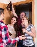 Family couple welcoming visitors at home Stock Photo
