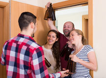 Family couple welcoming visitors at home Royalty Free Stock Image