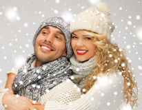 Family couple in a winter clothes. Bright picture of family couple in a winter clothes stock image
