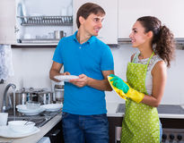 Family couple wiping dishes Royalty Free Stock Images