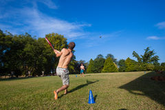 Play Baseball Hit Home. Family cousins play a little baseball pitch and strike ball late afternoon play Stock Images