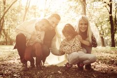 Happy family with blanket in park. Family covered with blanket in park royalty free stock photo
