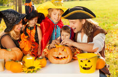 Family craft together Jack-O'-Lantern from pumpkin Royalty Free Stock Image