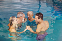 Family creating circle in water Royalty Free Stock Photography