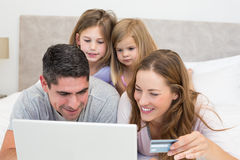 Family with credit card shopping online Stock Images