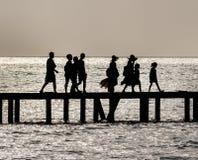 Family crossing bridge Royalty Free Stock Images