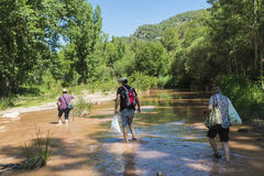 Family crossing a river Stock Photography