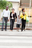 Family crossing a road. Stock Images