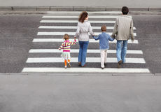 Family and crossing road, behind Royalty Free Stock Image