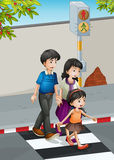 A family crossing the street Royalty Free Stock Photography